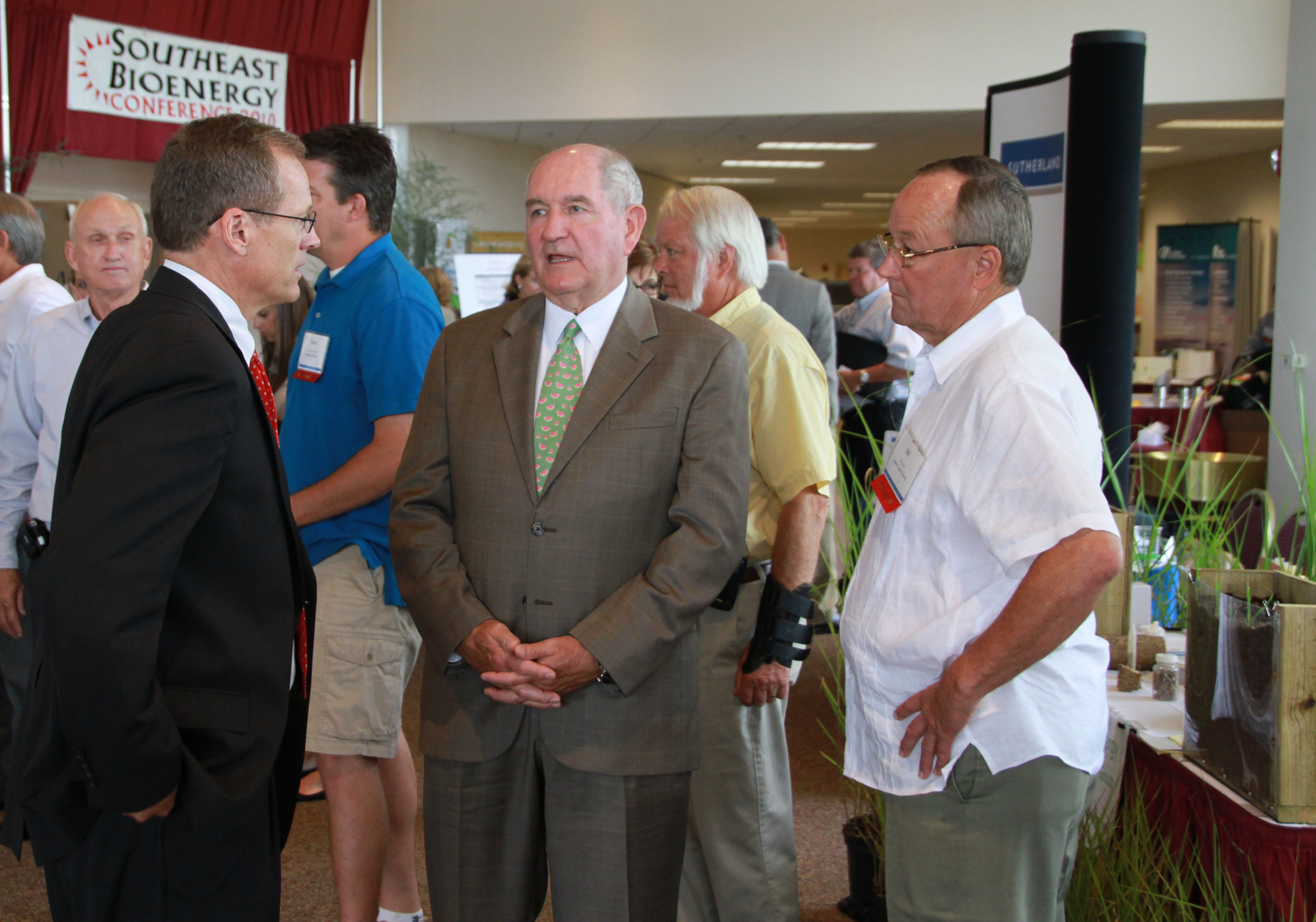 Georgia Gov. Sonny Perdue is shown (center) visiting with U.S. Rep. Jack Kingston (left) and Bill Brim (right) of Lewis Taylor Farms during the 2010 Southeast Bioenergy Conference.