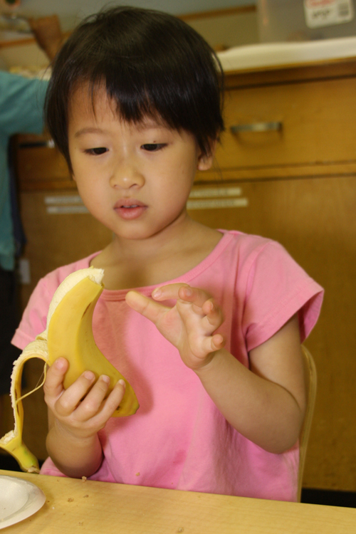 Child peeling banana. Spring 2010