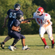 A Kings Bridge Middle School player gets ready for a tackle as his team plays Russell Middle School on a hot fall evening.
