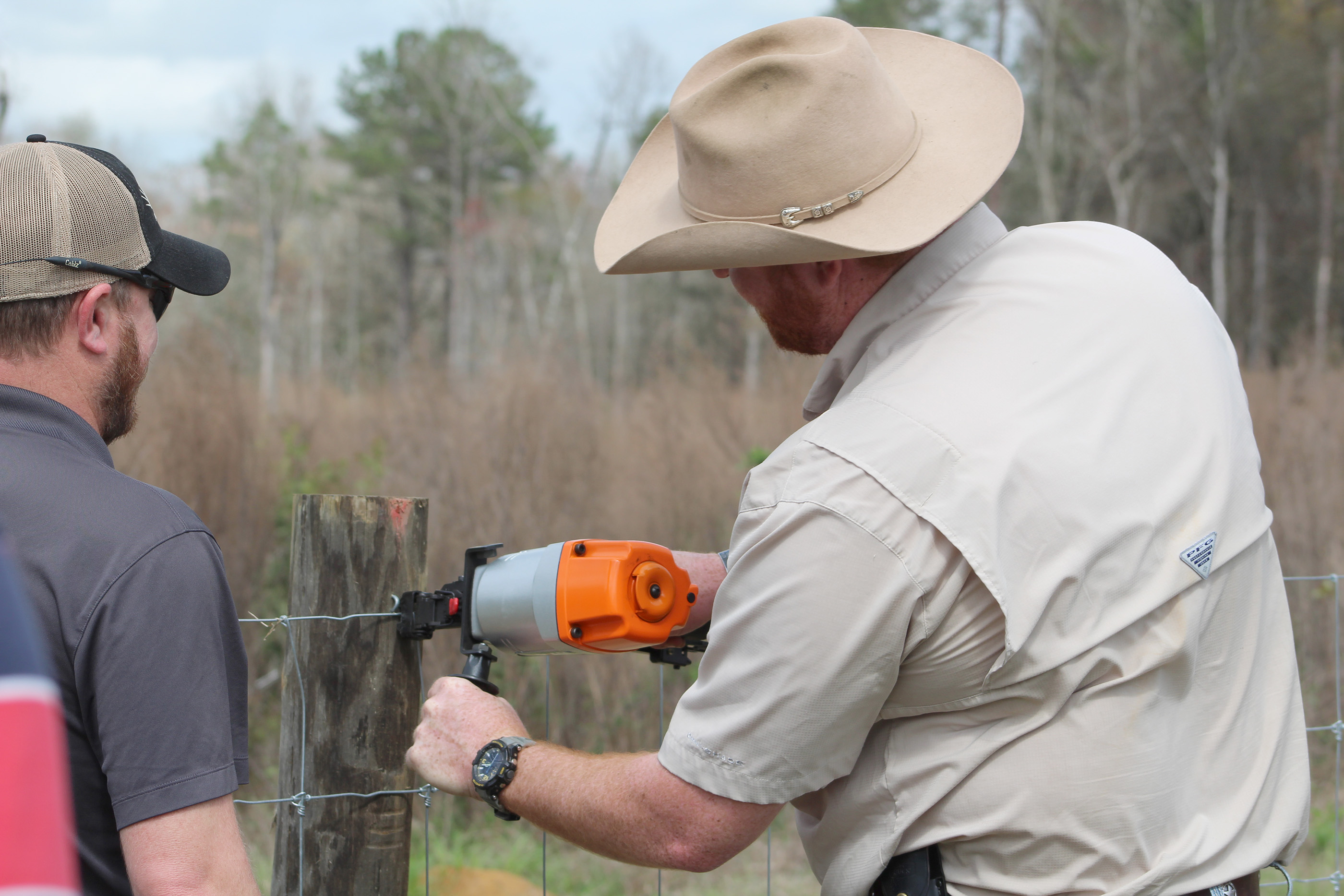 UGA's Will Cox staples a fence during a demonstration of the Fencing Field Day at the Blackshank Farm on the UGA Tifton campus.