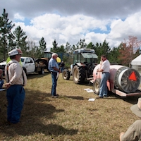 UGA Entomology Professor Glen Rains demonstrates sprayer calibration during UGA's Integrated Pest Management Field Day in Alma, Georgia.
