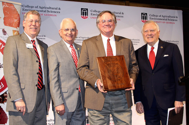 James Vaughn was named the 2018 Georgia Farmer of the Year during a ceremony held at the Georgia Freight Depot in Atlanta on Tuesday, March 20.  Pictured left to right are University of Georgia College of Agricultural and Environmental Sciences Dean Sam Pardue, Georgia Commissioner of Agriculture Gary Black, Vaughn and Georgia Governor Nathan Deal.