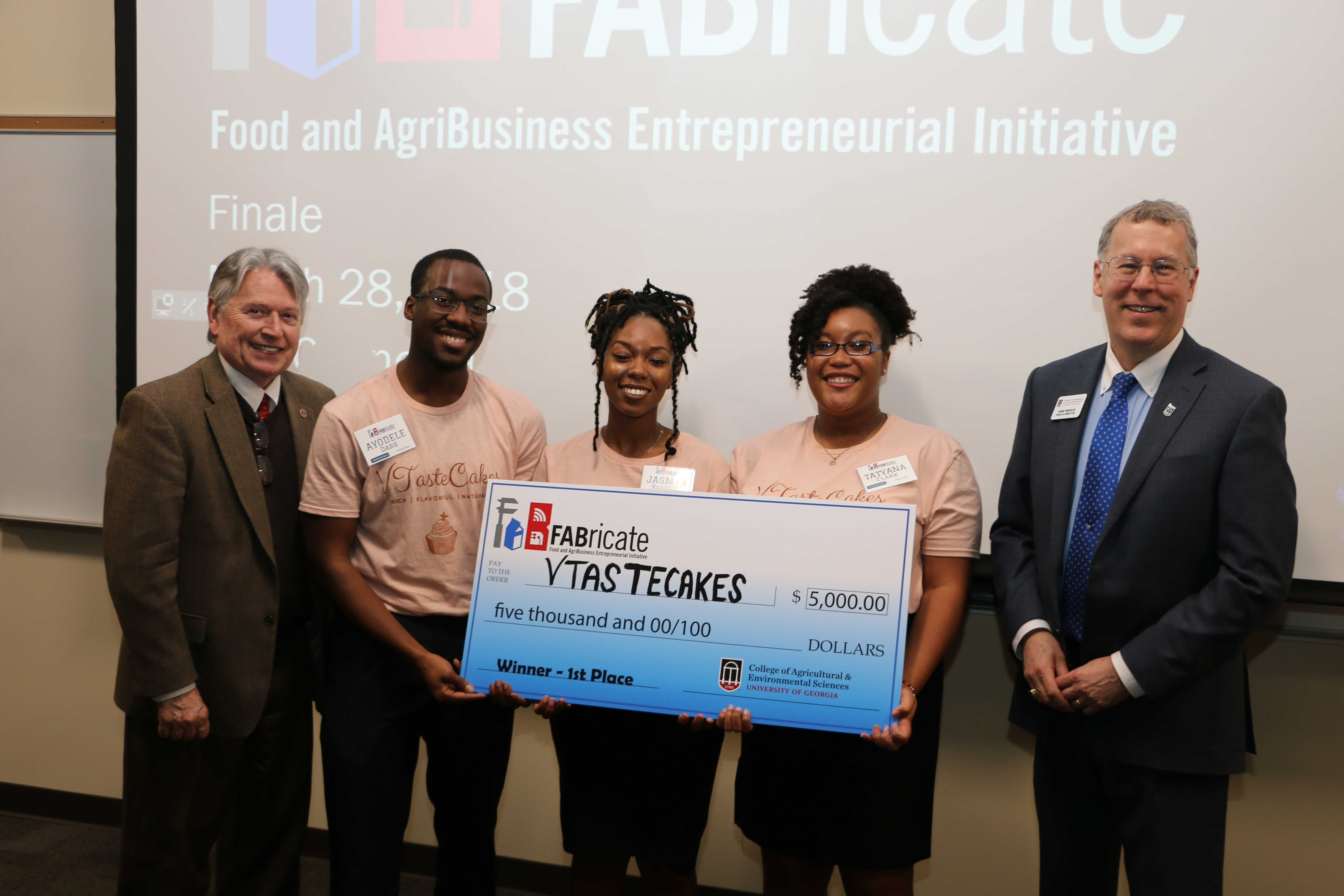 Josef Broder, UGA College of Agricultural and Environmental Sciences associate dean for academic affairs, congratulates VTasteCakes founders Ayodele Dare, Jasmyn Reddicks and Tatyana Clark, along with CAES Dean and Director Sam Pardue.