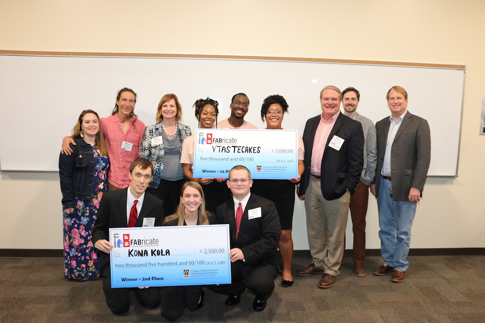 The UGA College of Agricultural and Environmental Sciences held its second annual FABricate entrepreneurship challenge, final pitch contest March 28 at Conner Hall.  Wished Trees', from left, Mary Kate and Rance Paxton; first place winners VTasteCakes' Jasmyn Reddicks, Ayodele Dare and Tatyana Clark and second place winners Kona Kola's John Tarleton, Alyssa Flanders and Lane Flanders pose with judges and supporters, from left, Laura Katz, Keith Kelly, Jim Flannery and Bob Pickney.