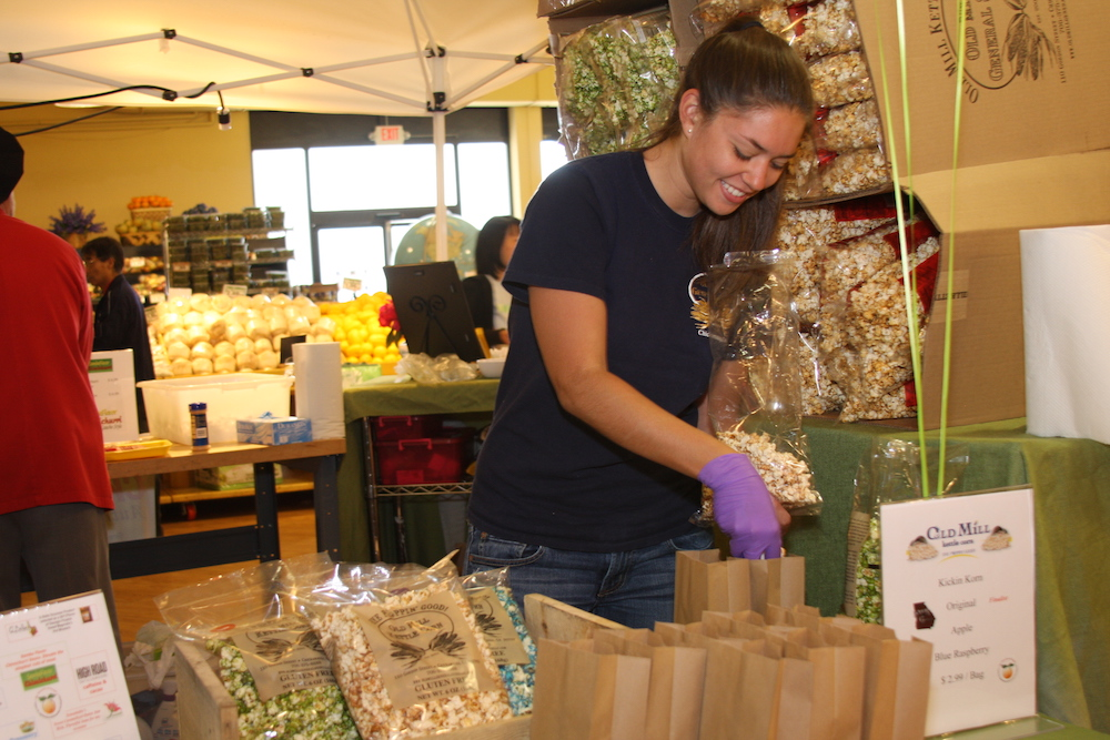 A food product entrepreneur serves up samples at a local grocery store.  University of Georgia Cooperative Extension is partnering with Fort Valley State University to host a small business workshop on June 19.