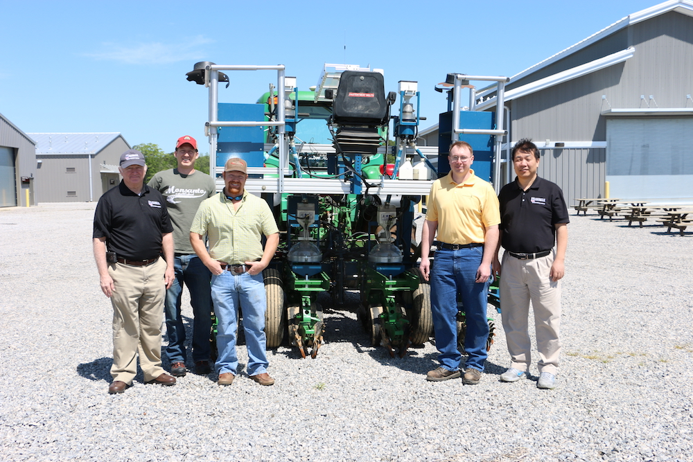 Crop and soil science research coordinator Dale Wood, from left, doctoral student Ben Stewart-Brown, research professional Brice Wilson, Monsanto fleet manager Brian Brand and Professor Zenglu Li stand with a new Alamco planter.