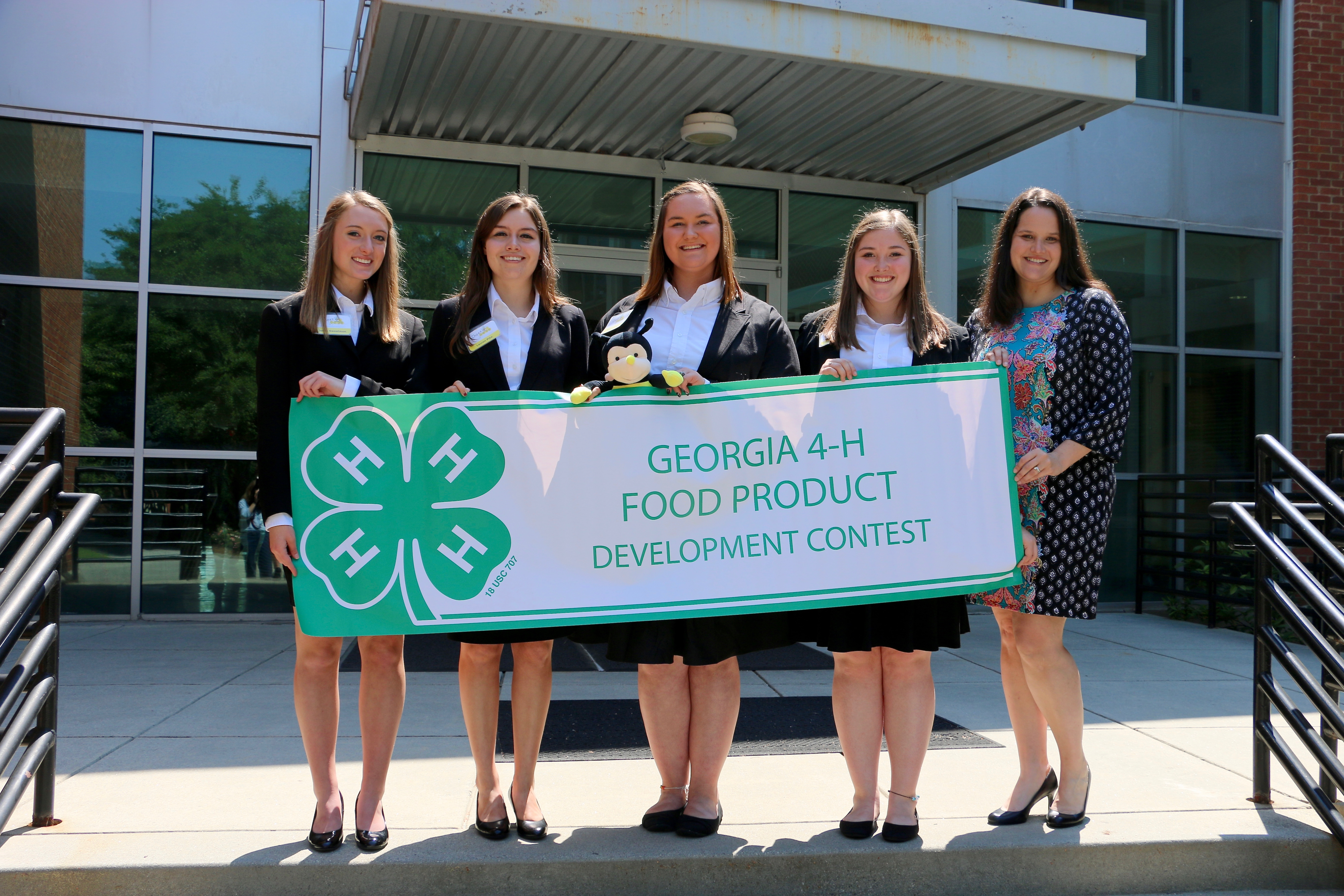 Walker County 4-H members (from left) Jenna Sweatmon, Lauren Pike, Tori Lawrence, Rylie Chamlee and 4-H agent and team coach Casey Hobbs celebrate after pitching their Cheez Beez snack cracker concept at the 2018 Georgia 4-H Food Product Development Contest.