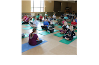 University of Georgia Cooperative Extension 4-H Youth Development agent from Heard County Dina Rowe, left, and Chatham County UGA Extension 4-H Youth Development agent Sergia Gabelmann teach 30 Georgia 4-H agents, assistants and volunteers the basics of yoga as part of training May 8 at Rock Eagle 4-H Center.