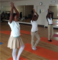 Georgia 4-H community club members at the Broad Street YMCA in Athens practice the tree pose during a Yoga for Kids class taught by UGA Cooperative Extension 4-H Youth Development agent Sergia Gabelmann