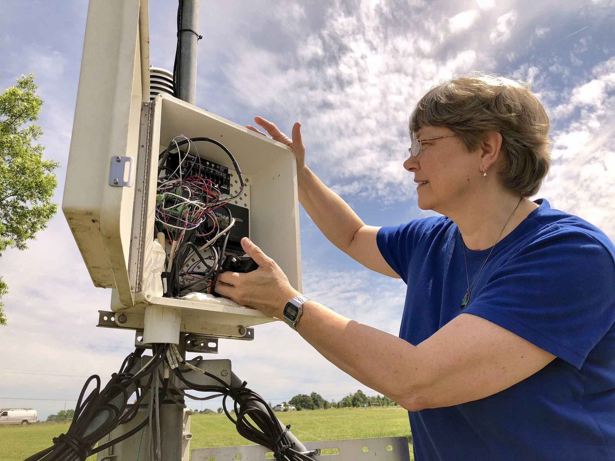 Pam Knox, newly named interim director of the University of Georgia Automated Environmental Monitoring Network, checks the data logger at the weather station on the Durham Horticulture Farm in Watkinsville, Georgia.