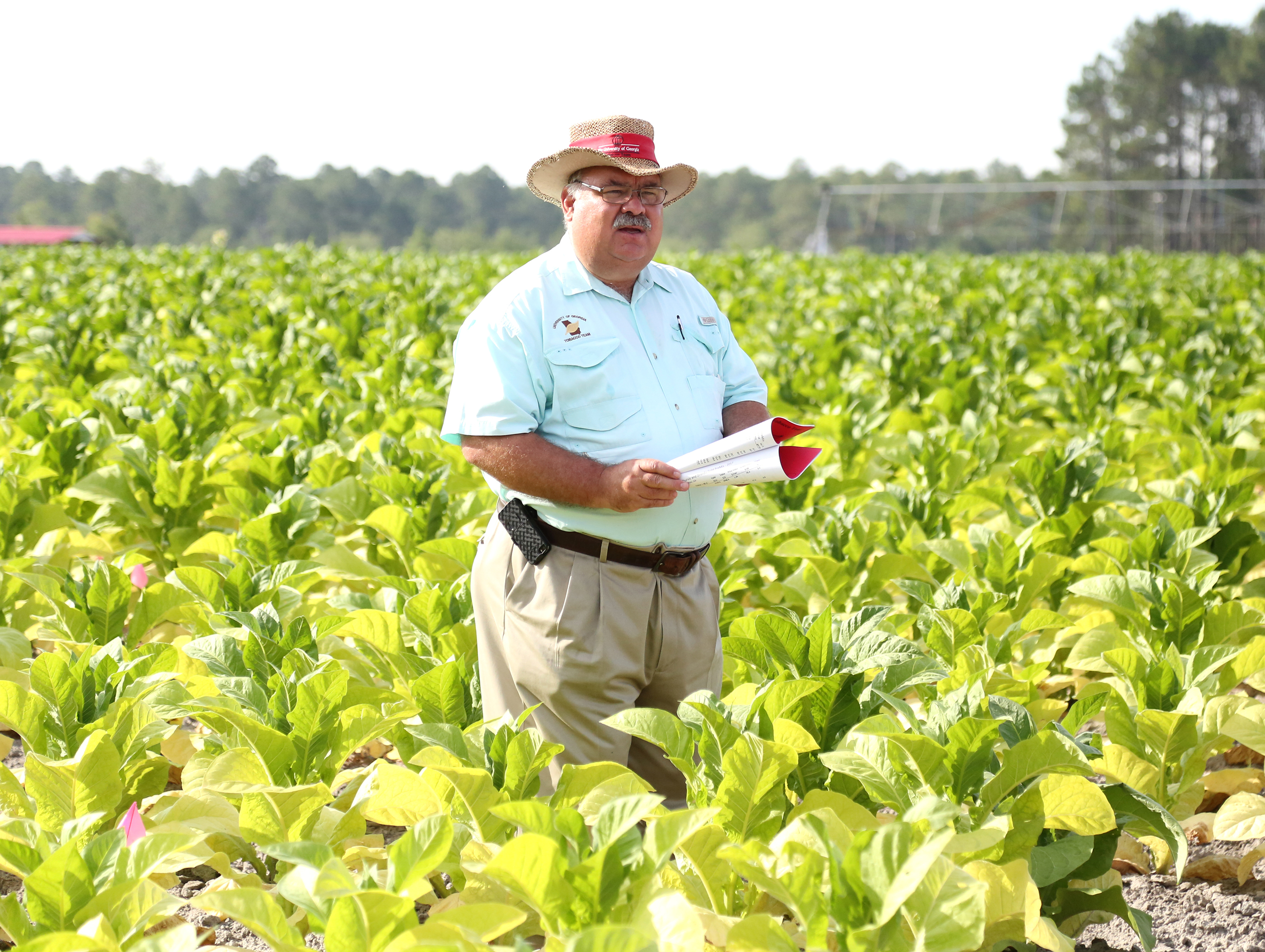 Extension tobacco agronomist J. Michael Moore speaks during the Tobacco Tour on June 13, 2018.