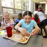 University of Georgia Cooperative Extension nutrition experts say the best way to teach your child to eat healthier is by being a role model. By eating fruits or vegetables you want them to try, you show your children that you aren't asking them to eat something that you don't eat.