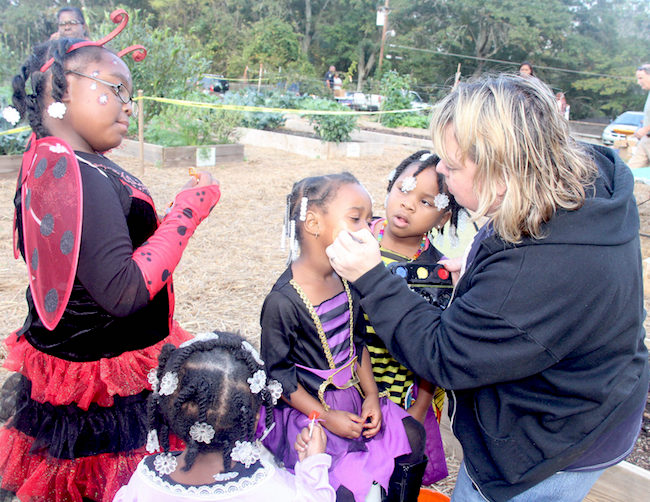 Events, like this Halloween celebration at the Healthy Life Community Garden in Griffin, Georgia, bring the public into community gardens. To help ensure a garden's long lifespan, it must be visible to people outside the group of garden supporters, says University of Georgia community garden expert Becky Griffin.