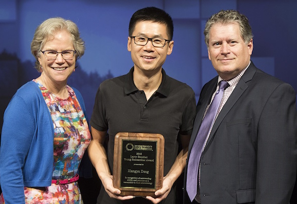 University of Georgia food scientist Xiangyu Deng has been awarded the Larry Beuchat Young Researcher Award by The International Association for Food Protection (IAFP). Deng is pictured (center) receiving the award from Linda Harris (left), a professor at The University of California, Davis and a past president of IAFP, and Stan Bailey (right), senior director of scientific affairs at bioMerieux and a past president of IAFP.