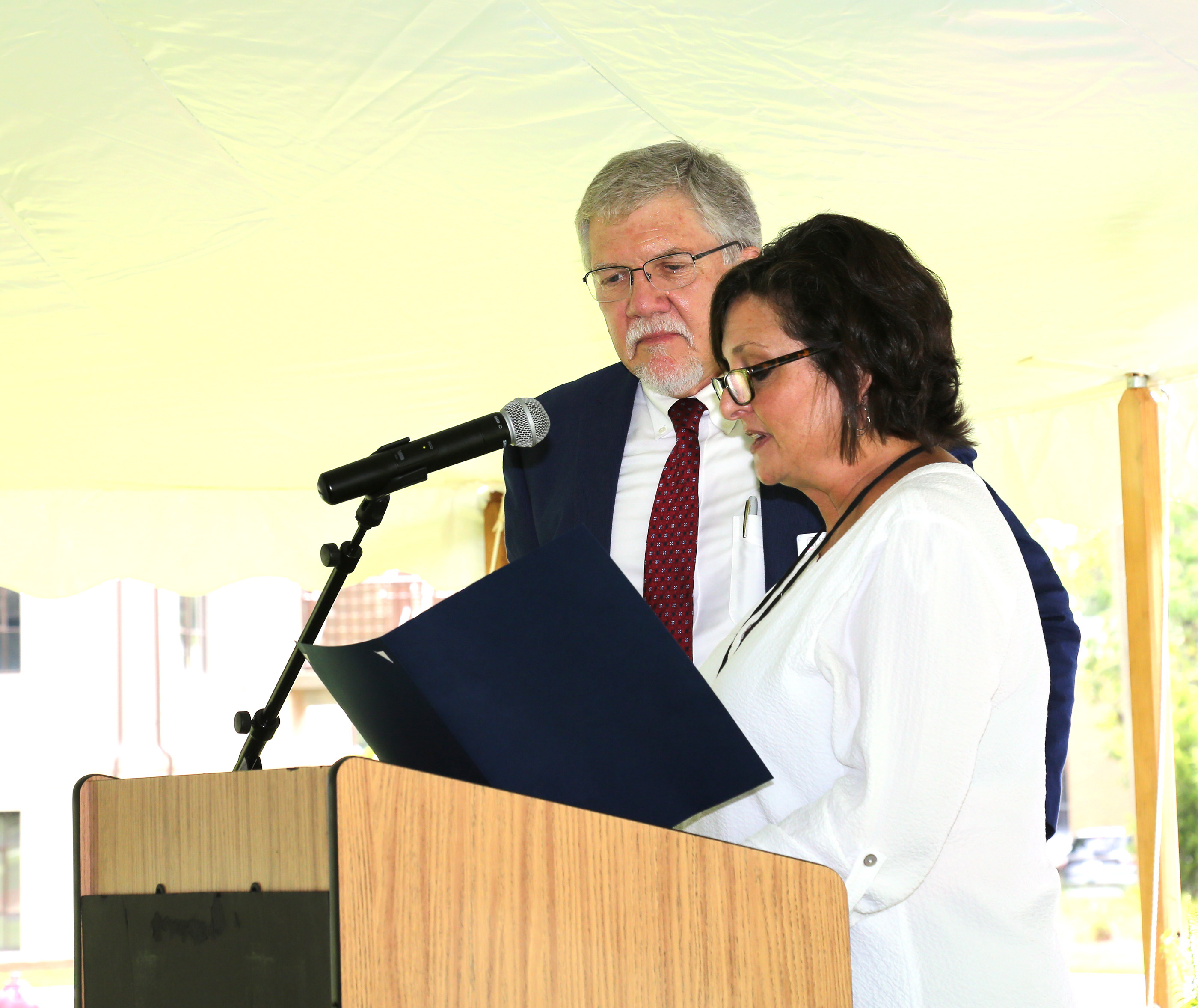 Tifton Mayor Julie Smith reads a proclamation issued to the UGA Tifton campus with assistant dean Joe West.  August 21, 2018