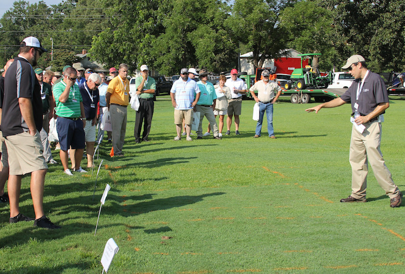 Patrick McCullough, UGA Extension weed specialist, was among the scientists who shared their findings at the UGA Turfgrass Research Field Day held on Thursday, Aug. 9, 2018. McCullough is shown telling visitors the results of his study on bluegrass control in Bermuda grass.