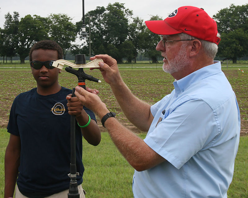 Calvin Perry instructs 4-H campers during the annual 4-H20 camp at Stripling Irrigation Research Park.