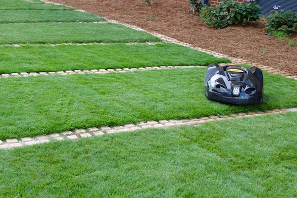 "University of Georgia Cooperative Extension Turfgrass Specialist Clint Waltz is currently using an ""automower"" on the lawn just outside the new UGA Turfgrass Research Facility on the UGA Griffin campus. The Husqvarna mower is on loan from Georgia sod producer Super-Sod, so Waltz can observe and evaluate the concept of ""continual"" mowing."