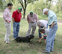 Eric Cohen and his dog Tate look for truffles during the Farm Tour on Tuesday, September 25.