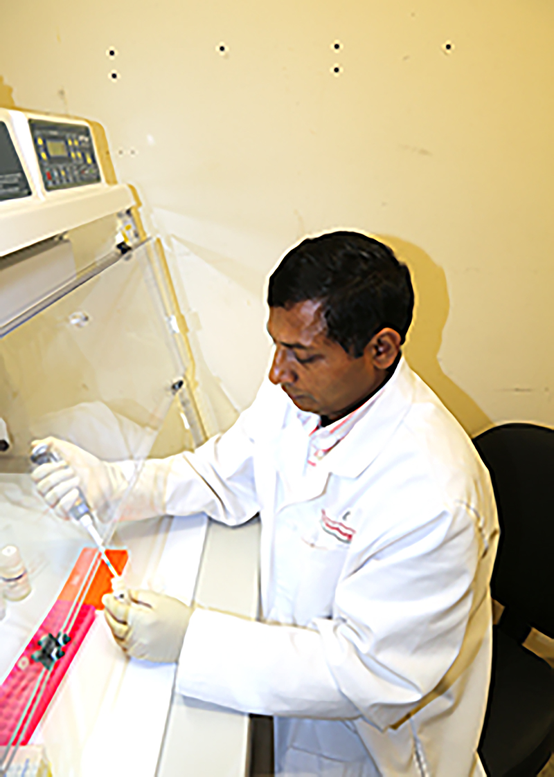Emran Ali works in the Plant Molecular Diagnostic Lab at UGA-Tifton.  August 30, 2018