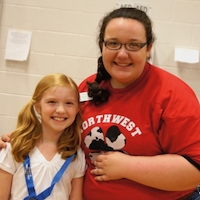A Fayette County 4-H'er celebrates with her agent after winning a Georgia 4-H Project Achievement competition.