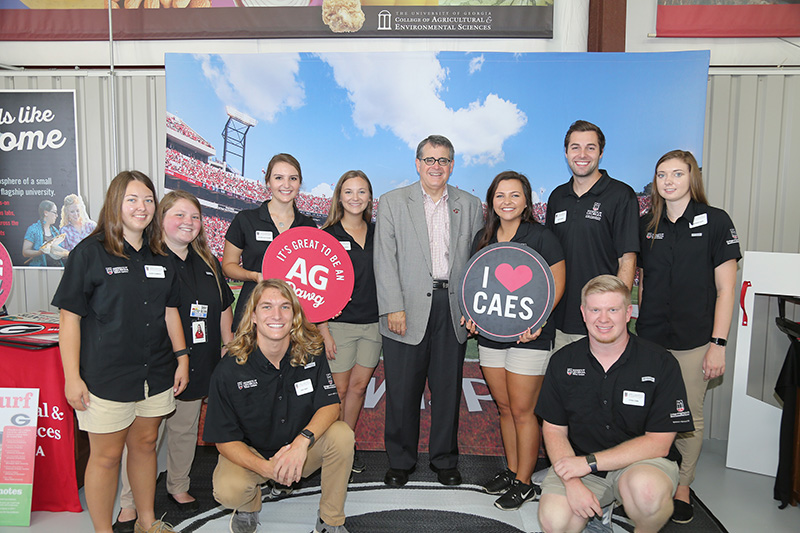 UGA President Jere Morehead is pictured with CAES Ambassadors during the first day of the Sunbelt Agricultural Expo in Moultrie, Georgia.