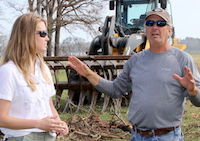 Decatur County farmer Bobby Barber, Jr., tells local University of Georgia Cooperative Extension Nan Bostick about the day Hurricane Michael struck his farm. A recent survey by the University of Georgia School of Social Work shows about 72% of survey respondents cited weather as the top stressor for Georgia farmers.