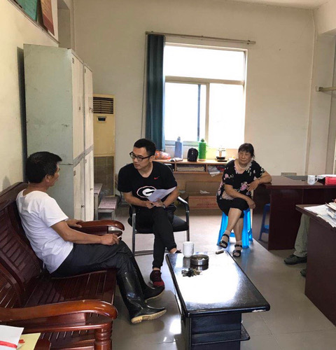 Zhongyuan Liu, a Ph.D. candidate in agricultural economics at the University of Georgia College of Agricultural and Environmental Sciences, talks to a farmer in China for a case study on land reform policies.