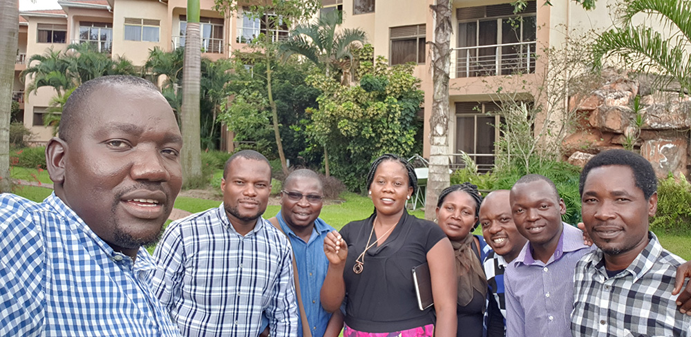 David Okello, the head of the groundnut improvement program for Uganda's National Agricultural Research Organisation (far left) hosted colleagues from other East African nations who are working to streamline their groundnut breeding programs through a breeding management software program and the Peanut Innovation Lab. Project participants include (from left): Justus Chintu of the Department of Agricultural Research Services in Malawi; Amade Muitia from the Mozambique Agricultural Research Institute (IIAM); Tonike Malema from Zambia; Mary Jacinta de Carvalho from Mozambique; Lutangu Makweti of the Zambia Agricultural Research Institute; Owiny Ronald  from Uganda; and Sinkala Willard from Zambia. Photo by David Okello