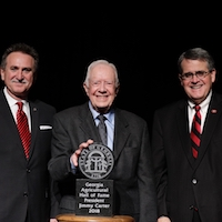 University of Georgia College of Agricultural and Environmental Sciences Alumni Association President Van McCall, left, and University of Georgia President Jere Morehead congratulate former President of the United States Jimmy Carter after his induction into the Georgia Agricultural Hall of Fame November 9 at UGA.