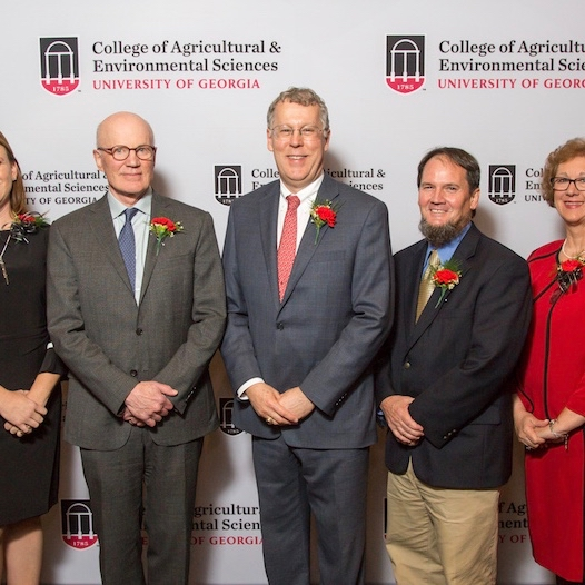 """Agricultural policy expert Robert Paarlberg, center left, and Dean Sam Pardue of the UGA College of Agricultural and Environmental Sciences, center, congratulate the winners of the 2018 D.W. Brooks Faculty Awards for Excellence including, from left, Professor Yen-Con Hung, Associate Professor Kari Turner, Professor Dan Suiter, Senior Public Service Associate Lisa Jordan, and Professor Qingguo """"Jack"""" Huang."""