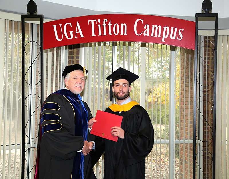 Stefano Gobbo is pictured with UGA-Tifton Assistant Dean Joe West during a graduation celebration held on the UGA Tifton campus on Saturday, Dec. 8, 2018. Gobbo is the first University of Padova student to earn a dual master's degree at UGA.