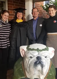 "Becky Griffin, recent University of Georgia graduate, says she was encouraged to complete her master's degree by ""Team Griffin,"" her affectionate term for her supporters, including her husband, Millard (center) and her daughters, Allison (left) and Mady (right)."