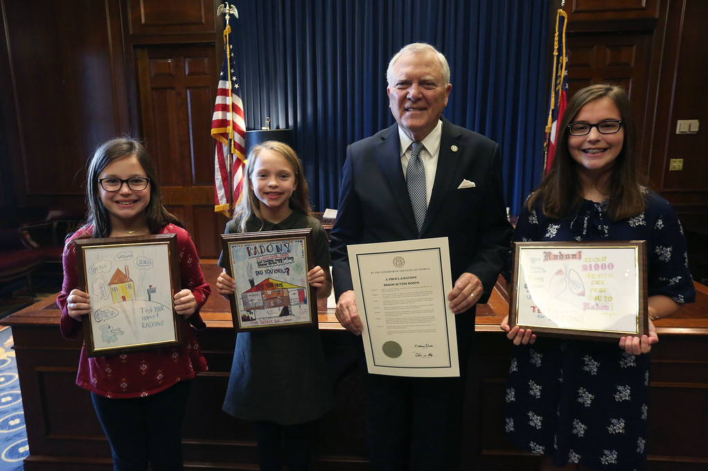 Georgia Gov. Nathan Deal congratulates, from left, David C. Barrow Elementary School fourth-grader Emma Starnes, David C. Barrow Elementary School fifth-grader Blake Bernt and Malcolm Bridge Middle School seventh-grader Olivia Hawkins. All three were named finalists in the 2019 UGA Extension Radon Education Program Poster Contest.