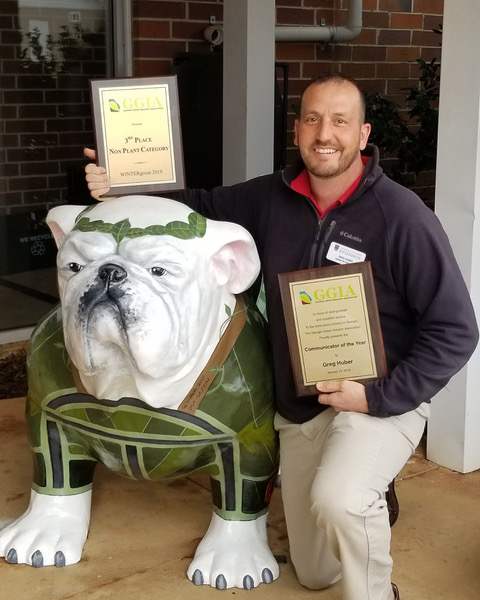Greg Huber, the training coordinator for the University of Georgia Center for Urban Agriculture, received GGIA's Communicator of the Year Award. The award honors the individual who best served the horticulture industry in Georgia through the media and other forms of promotion. He is shown with the center's personal UGA mascot, Agga. Huber designed the mascot which wears a green sweater and is adorned with plant life typically found in urban landscapes. Huber also designed the UGA Griffin Campus' original Uga mascot which is located on the campus quad where it welcomes visitors to the campus.