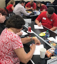 Participants in Extension Academy are shown writing their personal goal statements for their growth plan. UGA Cooperative Extension Agent Clark MacAllister said the program made him look inside himself and examine his own personality and how he is perceived by others.