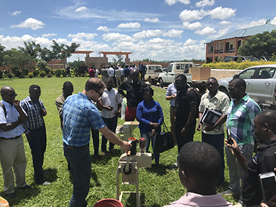 Peanut Innovation Lab Assistant Director Jamie Rhoads demonstrates a small-scale sheller in Malawi in March 2019 while working with the Malawi Agricultural Diversification Activity. Photo by Dave Hoisington