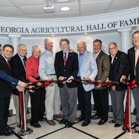 From left, Rep. Houston Gaines (Georgia House District 117), CAES Alumni Association President Van McCall and Georgia Agricultural Hall of Fame inductees Robert Lowery, Louie Boyd, Fred Greer, Abit Massey, Johnny Crawford, Wayne Hanna and Buddy Leger celebrate the dedication of the renovated hall of fame with CAES Dean and Director Sam Pardue.