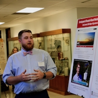 Cole Sosebee, a fourth-year student in the Department of Agricultural Leadership, Education and Communication, presents his research poster at the 2019 College of Agricultural and Environmental Sciences Undergraduate Research Symposium.
