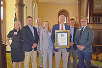 Joe West, assistant dean of UGA-Tifton, is presented a Georgia Trust Award for the renovation work done on the Tift Building and Agricultural Research Building. Pictured on the far left is Georgia Schley Ritchie, chair of the Georgia Trust for Historic Preservation; Will Sumner of Allstate Construction; Tony Menefee of Menefee Architects; Gwynne Darden, UGA associate vice president for facilities planning; Scott Messer, UGA director of historic preservation; and Mark McDonald, president and CEO of the Georgia Trust for Historic Preservation.