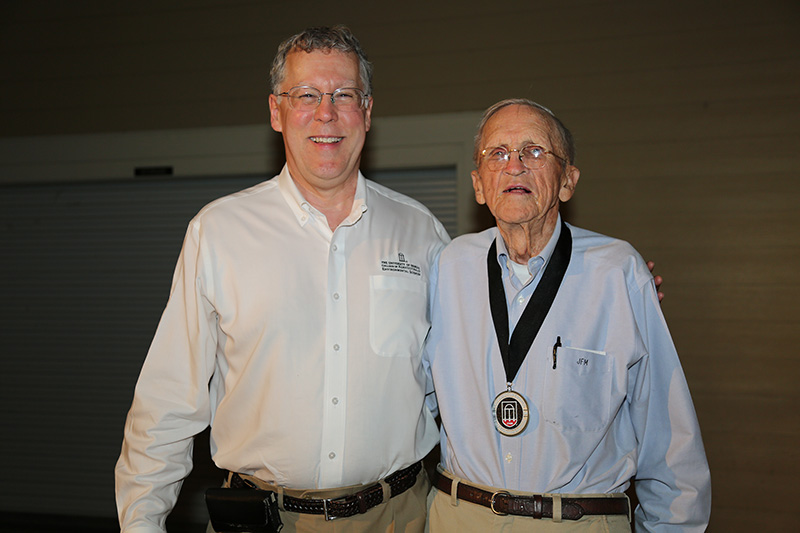 CAES Dean Sam Pardue, left, presented Frank McGill with the Medallion of Honor during special event on Thursday, May 2, on the UGA Tifton campus.