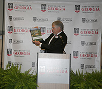UGA-Tifton Assistant Dean Joe West displays the campus' new centennial book, which documents the last 100 years of agricultural research and impact.