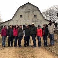 UGA Livestock Judging Team coach Sarah Loughridge, members Sadie Lackey, Morgan Rowan, Leanne Chafin, farmer owner John Turner, Ian Bennett, Anna Butler, Abigail Sartin and assistant coach Dylan Davis at an Angus farm in Tennessee.