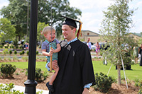 UGA-Tifton graduate Ben Hancock and his son, Johnny, blow the whistle following graduation on Saturday, May 4, on the UGA Tifton campus.