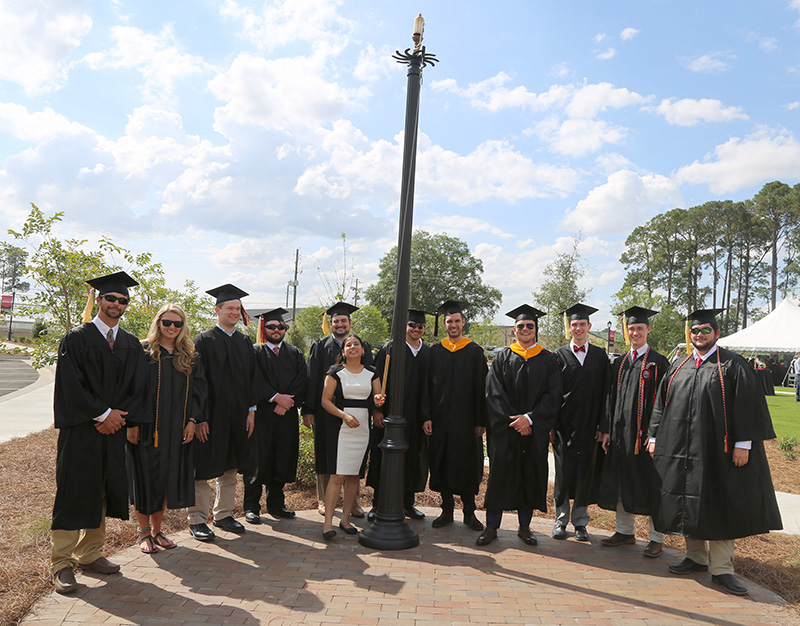 Spring graduates gather around the centennial whistle following a special ceremony honoring the UGA-Tifton graduates on Saturday, May 4, on the UGA Tifton campus.