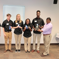 Terrell County's Georgia 4-H Food Product Development team won first place in this year's Food Product Development Contest with their take on kompot, a Slavic fruit drink. Georgia 4-H's Courtney Brown and Associate Professor Anand Mohan congratulates team members Sebastian Shattles, Hannah Grubbs, Janya Scott and Larry Hall.