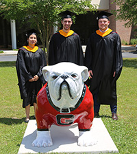 Samuele Lamon and Aaron Bruce were the two most recent graduates of the dual master's degree program between UGA and the University of Padova. They are pictured with Gurpreet Virk at the UGA-Tifton spring graduation ceremony on May 4, 2019.