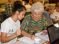 Murray County 4-H'er Charlsey Richards instructs her grandmother and Tech Changemakers student Betty Sue Grooms.