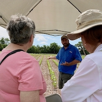 UGA Extension cotton agronomist Mark Freeman tells a crowd about the cotton variety trials being conducted at the J. Phil Campbell Sr. Research and Education Center at the farm's 2019 corn boil.