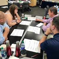 Members of the 2018-2019 class of the University of Georgia's UGA Extension Academy for Professional Excellence work on a group project during one of the leadership institutes in 2018.